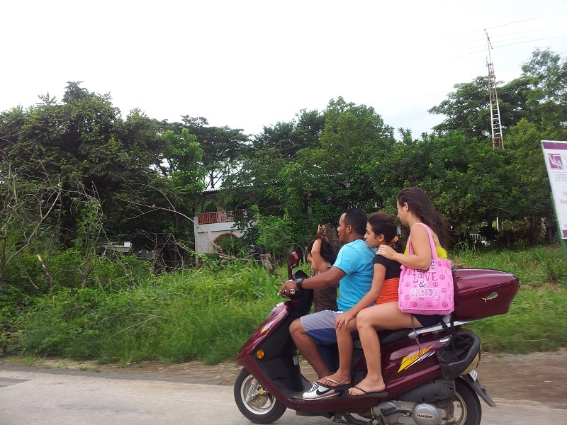Family of 4 on a scooter in Guanacaste, Costa Rica