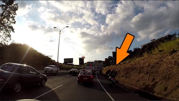 Motorcycle trying to pass using the shoulder