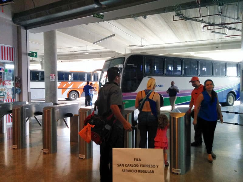 taking the bus from san jose to playa jaco first floor loading buses