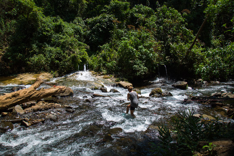 Walking across the river to the first Los Chorros waterfalls