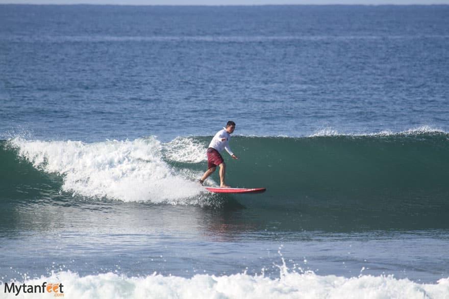 Surfing at Playa Hermosa beach